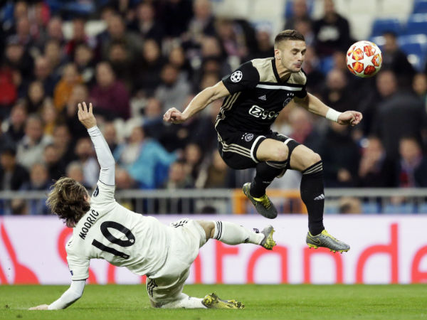 Champions League Real Madrid Out Spurs Cruise Into Quarter Finals
